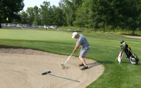 Kirk out of the sand for par!