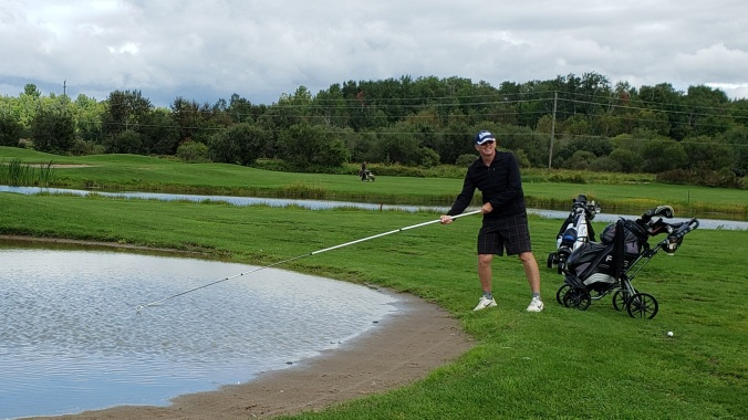 Blair Fishing Out a Golf Ball
